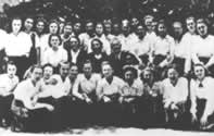 Magda at Jewish Girls' Gymnasium (high school) with a white bow in her hair (back row, center)